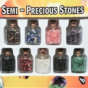 Coffret cadeau incluant 9 bouteilles de verre avec pierres semi-précieuses